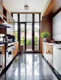 A modern kitchen by De la Torre Design Studio and Cooper, Robertson & Partners in New York