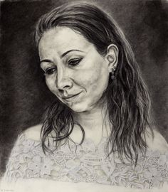 The Inward Smile - Charcoal on paper. 47 x 42 cm. This is my beautiful Sardinian friend Flavia in her serene Madonna-like pose. Her gaze is calm and benevolent. I did the highlights on her top with a China White pencil.