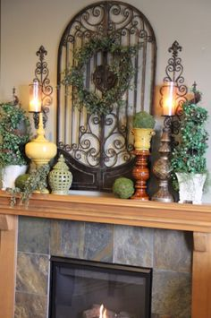 Mantel Decor reminds me of our fireplace minus the wood. cute decorations love