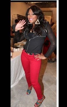 Trina is out and about in her black long sleeve sheer shirt