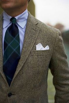Herringbone tweed jacket, blue/green plaid tie.