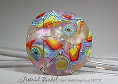 *Astrid Riedel*  Amazing lampwork artist and this bead is so pretty!!!