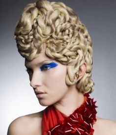 A long blonde curly plaited plaits coloured quirky avant garde hairstyle by Anne Veck Hair