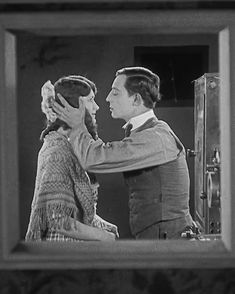 """""""animated_Buster Keaton kisses Kathryn McGuire in Sherlock Jr. (1924) directed by Buster Keaton """" SHERLOCK JR (1924) analysis by Jack Avery Throughout his cinematic career, Buster Keaton was never..."""