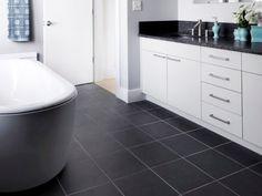 like these tiles. kitchen remodel designs: black kitchen floor