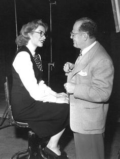 Rare photo - Greer Garson wearing eyeglasses. Seen here with her favorite cinematographer, Joseph Ruttenberg. Date unknown...likely late 1940s ?.