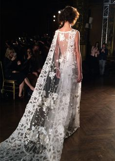 It's time to make an entrance and an exit! Long, flowing statement-making trains stole the show on the runways. Claire Pettibone Spring 2016 Wedding Dress