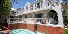 Two Berry House -  Une villa familiale de 4 chambres située à Llandudno, avec jardin, piscine et vue sur l'Océan Atlantique.