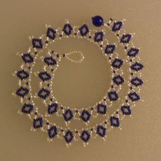 This beaded necklace looks intricate, but it is extremely easy to make. The beaded necklace is also inexpensive to make, since all you need are seed beads, thread and a beading needle. It is beaded using a simple netting stitch, which is common in Ukrainian and Russian beading. Get your supplies together and let's make a beaded necklace.