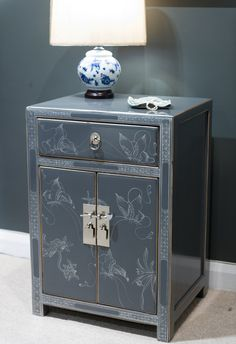 Grey decorated lacquer bedside cabinet