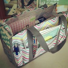 Keep It Caddy with stationary supplies. It looks really cool and really helpful for on the go moms and non-moms :) Not bad price either!