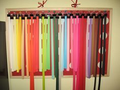Binder clips on bulletin board to organize quilling strips