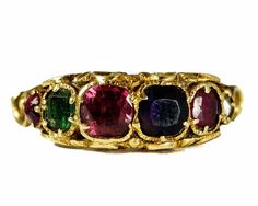 $750+  A wonderful quality Antique English 18ct gold Acrostic Ring. Set with six precious stones, Ruby, Emerald, Garnet, Amethyst, Ruby & Diamond. The first letter of each spell out the word 'REGARD', a common Victorian sentiment.     Ring Size:  UK: K 1/2 or US: 5 1/2   The final picture shows the piece next to a 1 cent piece for scale. (The coin measures exactly 19.9 mm in diameter or ¾ of an inch)   Measurements:   Head: 5.73mm x 16.28mm  Centre Stone: 4.1mm diameter.   Rise off Finger…