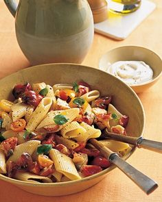 Pasta with Marinated Tomatoes and Lobster - Chunks of succulent lobster meld with heirloom cherry tomatoes and basil, making an otherwise familiar mix of late-summer flavors seem revelatory. A dollop of peppered mascarpone cheese provides a lavish finish.
