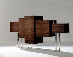 Design from Spain....wood cabinet with metal base, magnificent