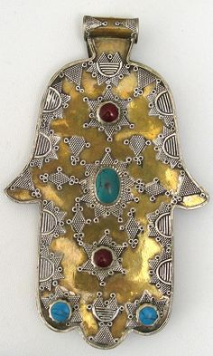 Ornate double sided gilded silver hand of Fatima pendant.