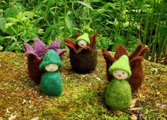 "Simple wetfelted ""little sprout"" finger puppets.  Great for a spring nature table, or a fairy-loving kid."