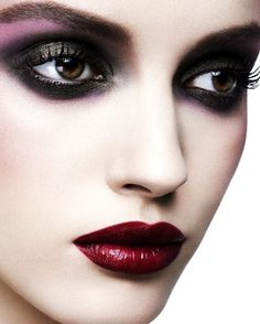 glittery dark black purple eye shadow, deep red semi-gloss lips
