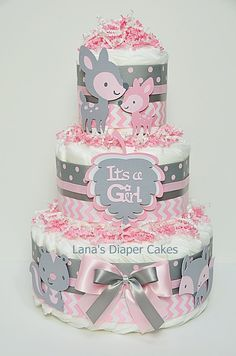 PLEASE READ STORE ANNOUNCEMENT BEFORE PLACING AN ORDER: https://www.etsy.com/shop/LanasDiaperCakeShop?ref=hdr_shop_menu  Woodland Baby Animals Pink And Gray Chevron Diaper Cake Would make a wonderful gift for new baby or stunning centerpiece for a baby shower. Something any Mother would appreciate and never forget. Unique and Practical. Will be the hit of the Baby Shower guaranteed!  Ingredients: 45 Premium Diapers (size 1) Cute Woodland Animals The cake Measurements approximately: 10W X 14H…