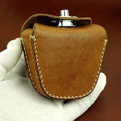Handmade Thick Genuine Leather Ammo Pouch Storage Bag for Slingshot Balls Rifle Pellets. Totally Handmade Thick Genuine Leather Pouch. Made in about 1970S for chinese Army. With Belt Lope. we improve the magntic to Rotating button for thick leather. Perfectly holds 100 rounds of .22lr.