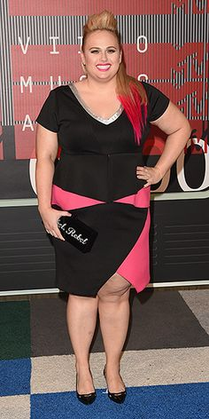 The Best and the Boldest Looks of the Night | REBEL WILSON | The comedian always brings it on the red carpet, this time debuting new pink tips to go with her magenta-accented Eloquii dress.