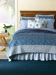 Forget-Me-Not Quilt - Our floral quilt ushers in spring with quiet  simplicity. In beautiful shades of blue, the  diamond-quilted center is framed by a white  minifloral