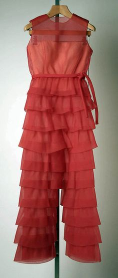 Evening ensemble (a, b) House of Givenchy (French, founded 1952)  Designer:     (a, b) Hubert de Givenchy (French, born Beauvais, 1927) Date:     fall/winter 1968–69 Culture:     French Medium:     synthetic, silk, leather Dimensions:     Length at CB (a): 19 1/4 in. (48.9 cm) Length at CB (b): 48 in. (121.9 cm) Length (c, d): 10 1/4 in. (26 cm)