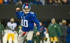 Eli Manning reacts to a Giants score - and there were plenty of them.