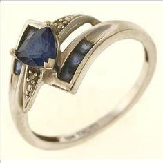 1.9 Gram 10kt White Gold Ring With Blue Stones And Diamond Accents  http://www.propertyroom.com/l/19-gram-10kt-white-gold-ring-with-blue-stones-and-diamond-accents/9543204