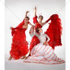 Three Young Women Dancing Flamenco · GL Stock Images