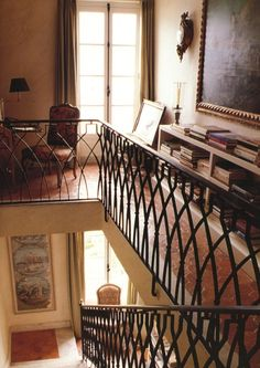 ~Clos Fiorentina; an interior stairway, with gorgeous railings & terra cotta floors. Givenchy's house at Saint Jean Cap Ferrat, in the French Riviera. From the book, THE GIVENCHY STYLE. via markdsikes.