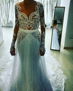 This sexy long sleeve wedding dress has a removable skirt. Haute couture wedding gowns like this can be costly.  But our dress design firm can make a #replica of any couture dress for you and it will look similar but cost much less.  We can work from any picture you have from the internet. Custom wedding dresses & replicas are affordable at www.dariuscordell.com