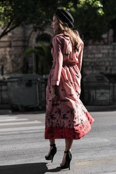 If you can't travel to Paris, now you can wear it. With a pattern uniquely designed for Karavan Clothing (a whole world on it), a wrap feminine front and a V-ne