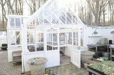 I luuvvv this greenhouse!  http://www.clausdalby.dk/