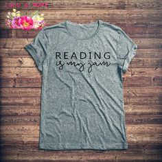 Reading is my Jam Shirt  Calling all book lovers! You know reading is your jam, so why not showcase your love for reading with this super soft tee. Shirt is available in Unisex for a relaxed look. Check the product pictures for sizing. I love making custom tees! What to change something? Let me know by clicking the contact seller button.