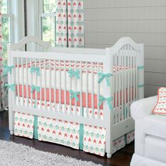 """Crib Dust Ruffle in Coral and Teal Arrow by Carousel Designs.  Think outside the box and get creative! Get your crib picture perfect with our two-pleated crib skirt. This skirt features two pleats in coordinating fabric. Finished length approximately 13-14 inches. Fits standard cribs using mattresses measuring approximately 28"""" x 52"""". Dry clean only."""