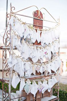 Whimsical Touches - This wedding featured a wall of lovely vintage handkerchiefs that guests could use to dry their eyes during the ceremony.