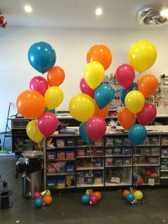 """Fun fiesta colours - island blue, wildberry, orange and yellow in a mix of regular oval 12"""" and 17"""" round balloons"""