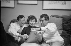 Leonard Bernstein with Betty Comden and Adolph Green looking at pages. (1949)  Stanley Kubrick, photographer