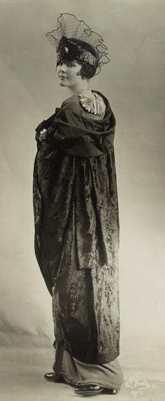 Woman wearing fur cloak and lace hat, 1915