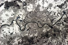 Köln (Cologne), Germany. The old city street patterns fanning from the Rhine, visible from space.