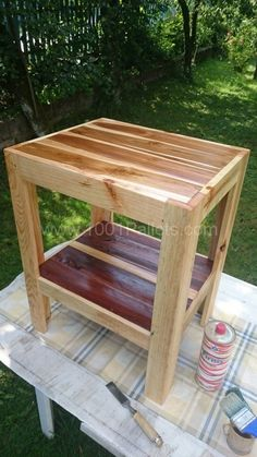 A small garden coffee table made entirely out of reclaimed pallet wood