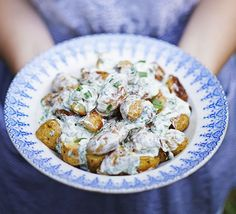 Roast new potato salad with caper & tarragon dressing. A classic potato salad updated with a herby soured cream dressing, perfect for serving with fish, barbecued meat and many an alfreso feast
