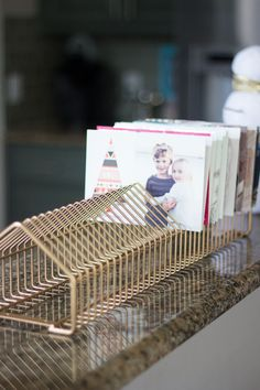 This thrifty DIY project transforms an old CD rack into a Christmas card holder with gold spray paint. A modern and practical way to display holiday cards! Cd Diy, Christmas Card Display, Christmas Card Holders, Modern Christmas, Christmas Holidays, Christmas Crafts, Xmas, Karten Display, Cd Holder