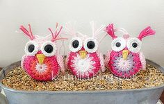 handmade stuffed crochet owls .. pinks and white  ... shiny black eyes ... luv the whisps of thread sticking up from their heads ...