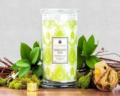 Fresh citrus notes and a hint of fruit lead to the shimmering floral accord at the heart of this soothing blend.  This bouquet is texturized with green leafy tones and sheer woods as it fades to reveal the sensual base of exotic sandalwood and musk.  Find a hidden ring surprise worth $10 to $7500 in each of our hand-made, all natural soy candles.