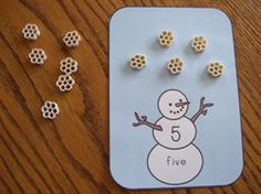 Snowflake math activity. You could use other counters instead of cereal as well.