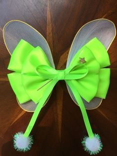 """""""Faith, trust, and just a little bit of pixie dust.""""  This is my limited edition Tinkerbell hair bow. I will not have it for long, so get your orders in   #missmaegansbowtique #missmaeganbowtique #missmbowtique #hairbows #handmade #hairbow #crafty #disney #disneylover #disneybounding #fairies #pixiedust #magic #tinkerbell #peterpan @disneystudios @missmbowtique"""