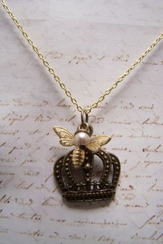 Queen Bee Necklace with Crown by EmilinaBallerina on Etsy, $15.00.  I love this necklace.