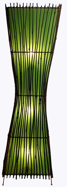 Satori floor lamp. Hourglass-round shaped floor lamp made from dark bamboo and silk lining. Wonderful ambient lighting for indoors or outdoors.